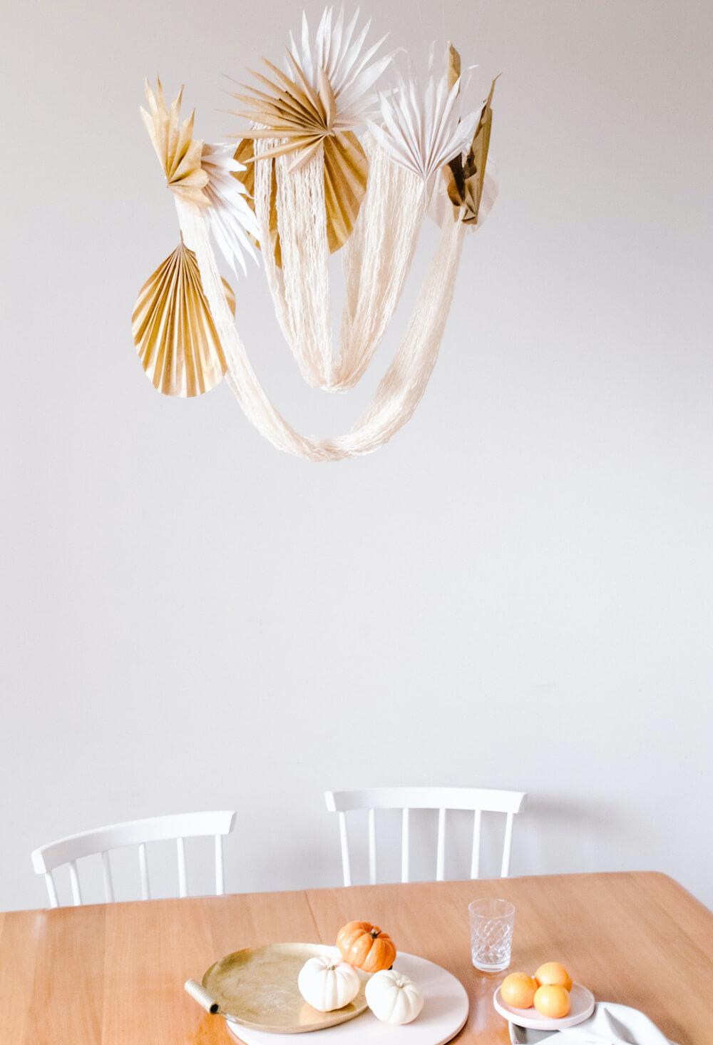 DIY Boho Yarn and Palm Frond Chandelier.